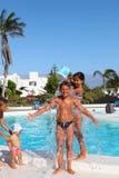 Children Playing Near Pool Royalty Free Stock Photo