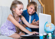 Children playing online on laptop royalty free stock photography