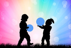 Children playing outdoors Royalty Free Stock Photos