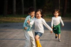 Children playing outdoors Royalty Free Stock Photography