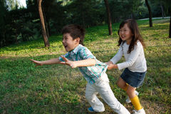 Children playing outdoors Stock Photos