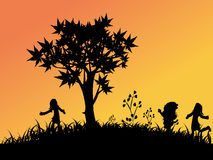 Children playing outside. Silhouettes of Children playing outside Royalty Free Stock Photos