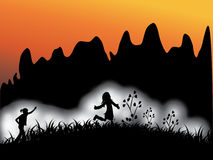 Children playing outside. Silhouettes of  Children playing outside Royalty Free Stock Images