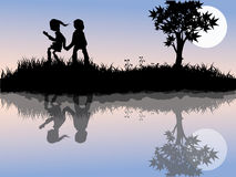 Children playing outside. Silhouettes of  Children playing outside Stock Photo