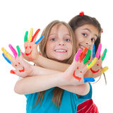 Children playing with paint. Happy smiling children playing with paint Stock Photo