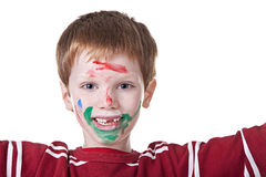 Children playing with paint, with painted face. Hand hint of red, with the kid blurred Stock Photo