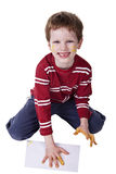Children playing with paint, stamping his hand on. A white sheet, isolated on white background Stock Photography