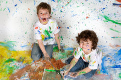 Children playing with painting Stock Image