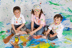 Children playing with painting Royalty Free Stock Photo