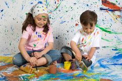 Children playing with painting Stock Photography