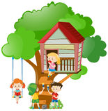 Children playing and painting treehouse Stock Images