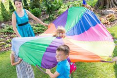 Children playing parachute games stock photo