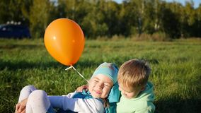 Happy children playing in the Park. Balloon. The laughter and smiles of children stock footage