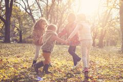 Small children playing in park. Children playing at park and holding hands stock photo