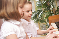 Children Playing the Piano Stock Images