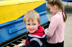 Children playing piano Stock Images