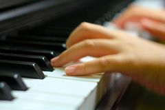 Children hand on piano key Royalty Free Stock Image