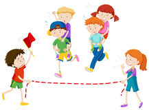 Children playing piggy back ride race Royalty Free Stock Image
