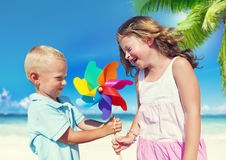 Children Playing with the Pinwheel on a Beach Stock Photography