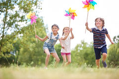 Children playing with pinwheels Royalty Free Stock Photo
