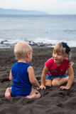 Children playing on the Playa la Arena black volcanic sand beach. Tenerife, Canary islands, Spain Royalty Free Stock Image