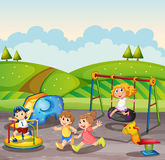Children playing in the playground at daytime Stock Images