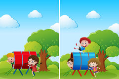 Children playing in playground at daytime Stock Photos