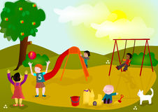 Children playing on playground. Multi-ethnic children playing on outdoors playground Royalty Free Stock Images
