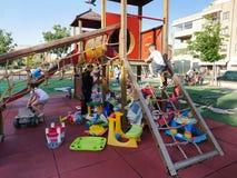Children playing at playground Royalty Free Stock Image