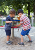 Children playing at playground. Children playing with sand at playground on a play table equipment stock images