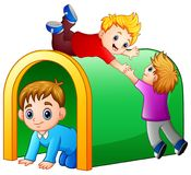 Children playing playground tunnel Royalty Free Stock Photo