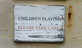 Children Playing - Please Take Care Stock Photo