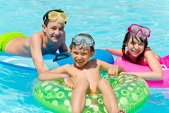 Children playing in pool stock image