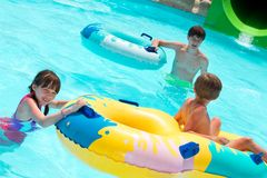 Children playing in pool Royalty Free Stock Photos