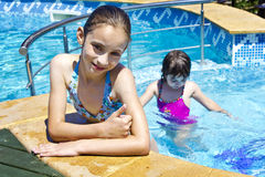 Children playing in pool Royalty Free Stock Photo