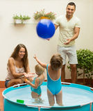 Children playing in pool Stock Images