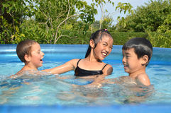Children playing in the pool Stock Photography