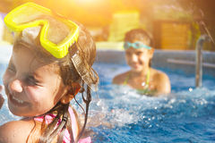 Children playing in pool. Two little girls having fun in the poo Stock Photo