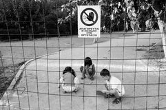 Children playing in prohibited area Royalty Free Stock Image