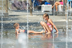 Children playing in puddle on hot weather Stock Photo