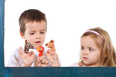 Children playing with puppets. Children playing with finger puppets - isolated Royalty Free Stock Images