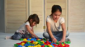 Children playing with puzzle stock footage