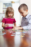 Children, playing puzzles Stock Image