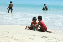 Children playing in Radha Krishna beach. Unidentified children playing with sand in Radha Krishna beach, Andamans, India. Radhakrishna beach is the most Stock Photography