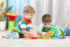 Children playing rail road toy Stock Photo
