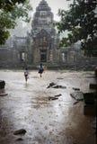 Children playing in the rain Stock Photo
