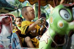 Children playing. They 're up a game named odong - odong royalty free stock photography