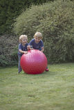 Children playing with relaxing balloon Stock Image