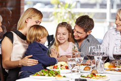 Children playing in restaurant. Two children playing together in a restaurant during family visit stock images