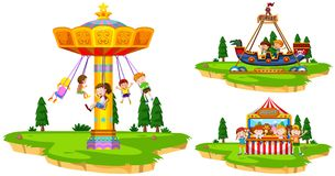 Children playing on rides in the park Royalty Free Stock Photos
